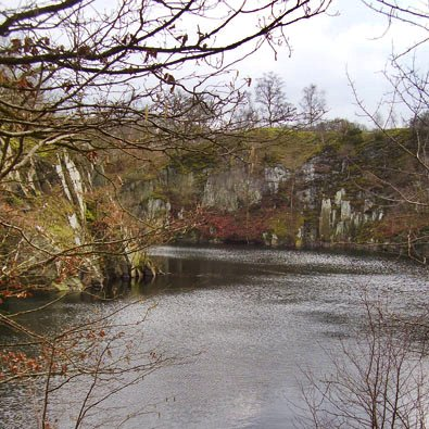 Water filled former slate pit in Swithland Woods said to be 150 ft deep